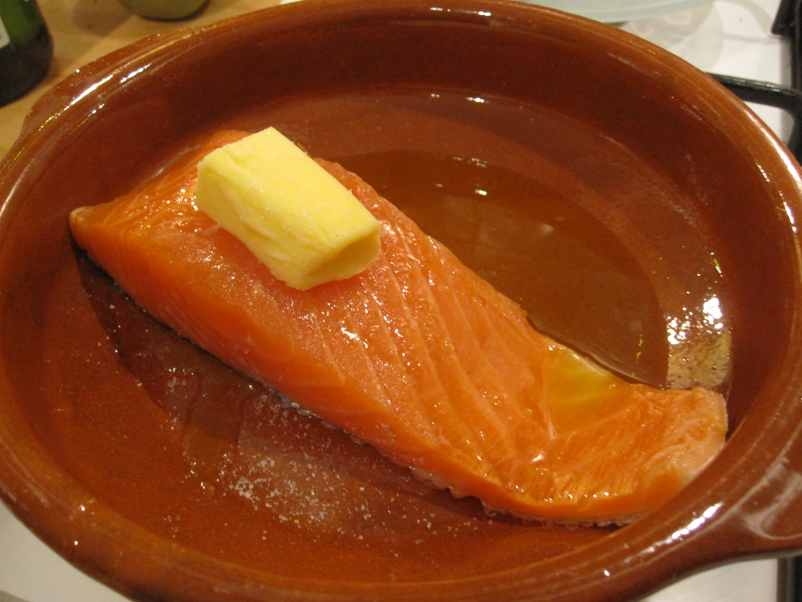 Put The Salmon In An Ovenproof Dish, Pour Over A Little Olive Oil And Smear  Round The Fish, Then Put A Knob Of Butter On The Top And Put Into A 180